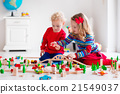 Children playing with toy railroad and train 21549037