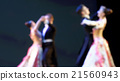 Defocused image of dancing people 21560943