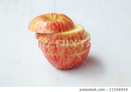 apple slices on white wooden background 21568959