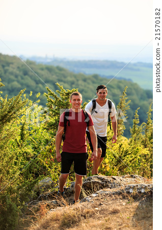 Two men hiking on the top of mountain 21570182