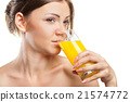 Young beautiful woman drinking orange juice 21574772