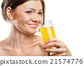Young beautiful woman drinking orange juice 21574776