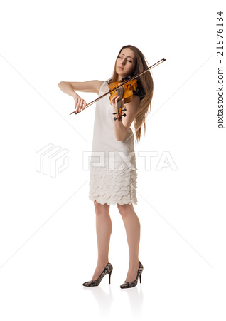 Beautiful young woman playing violin over white 21576134