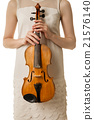Beautiful young woman playing violin over white 21576140
