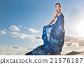 beauty woman in blue dress on the desert 21576187