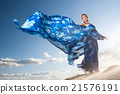 beauty woman in blue dress on the desert 21576191