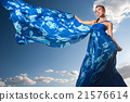 beauty woman in blue dress on the desert 21576614