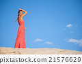 beauty woman in red dress on the desert 21576629