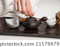 Chinese tea ceremony is perfomed by master 21576679
