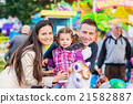 Father, mother, daughter enjoying fun fair ride 21582887