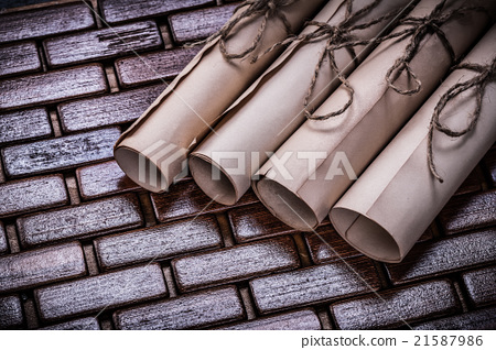 Stock Photo: Pile of vintage parchment rolls on wicker wooden