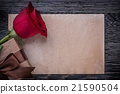 Vintage paper red rose wrapped gift box on wooden 21590504