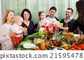 Family celebrating girl's birthday 21595478