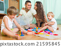 Happy family playing in home interior 21595845