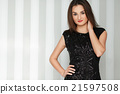 Young beautiful stylish girl with red lips posing 21597508