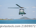 Helicopter flying over the sea 21609072