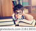 seven years old child reading a book 21613633