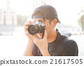 Portrait of young photographer shooting photo 21617505