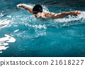 Muscular young man swims the butterfly 21618227