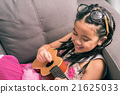 Happy smiling girl learning to play the Ukulele 21625033