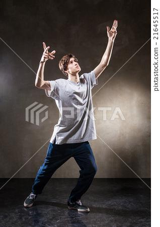 urban hip hop dancer over grunge concrete wall 21645517