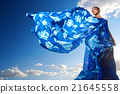 beauty woman in blue dress on the desert 21645558