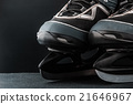 Pair of skates on the dark background 21646967