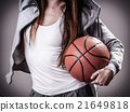 Sporty girl holding basketball 21649818