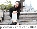 Touching a tablet terminal Straight long haired young lady 21653844