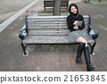 Touching a tablet terminal Straight long haired young lady 21653845