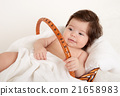 baby portrait in basket with white towel 21658983