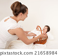 mother and baby portrait on white, health family and care concept 21658984