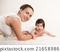 mother and baby portrait on white, health family and care concept 21658986