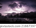 Thundercloud illuminated by lightning 21667397