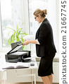 businesswoman in black suit using printer on table 21667745