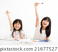 happy children painting in the classroom 21677527