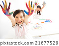 happy little girls with hands in the paint 21677529
