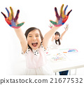 happy little girls with hands in the paint 21677532