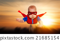 toddler little baby superman superhero with a red cape flying th 21685154