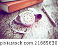 Pocket watch and book with pen, On old wood. 21685630