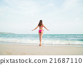 Young and fit woman in a swimsuit on the beach 21687110