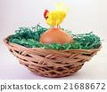 Hen on egg in basket 21688672