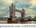 Tower Bridge under cloudy sky. 21694308