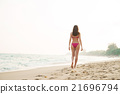 Young woman in a swimsuit on the beach 21696794