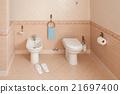 Slippers Near Bidet In Home Bathroom 21697400