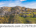 Rupestrian house and church, historic building. Sassi of Matera. Basilicata under blue sky 21707919