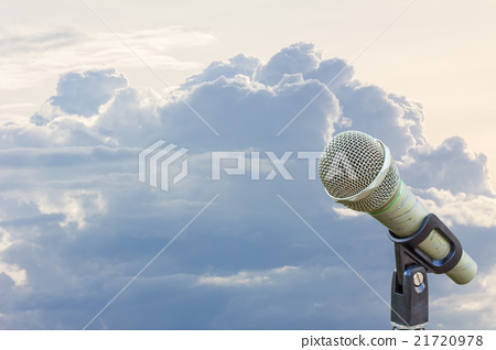 microphone on a stand with cloud before raining 21720978