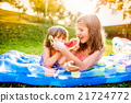 Two cute girls eating watermelon in sunny summer 21724772