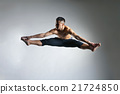 Caucasian man gymnastic leap posture on grey 21724850
