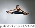 Caucasian man gymnastic leap posture on grey 21724850